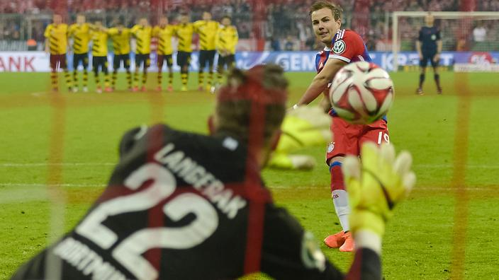 Dortmund's Australian goalkeeper Mitchell Langerak saves Bayern Munich's midfielder Mario Goetze's penalty during the German Cup DFB Pokal semi-final football match FC Bayern Munich v Borussia Dortmund in Munich, southern Germany, on April 28, 2015. Dortmund won the match 1-3 after penalties. AFP PHOTO / GUENTER SCHIFFMANN +++ RESTRICTIONS / EMBARGO ACCORDING TO DFB RULES IMAGE SEQUENCES TO SIMULATE VIDEO IS NOT ALLOWED DURING MATCH TIME. MOBILE (MMS) USE IS NOT ALLOWED DURING AND FOR FURTHER TWO HOURS AFTER THE MATCH. FOR MORE INFORMATION CONTACT DFB DIRECTLY AT +49 69 67880 (Photo credit should read GUENTER SCHIFFMANN/AFP/Getty Images)